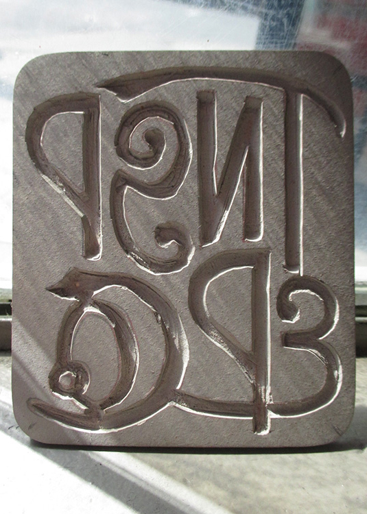logo carving